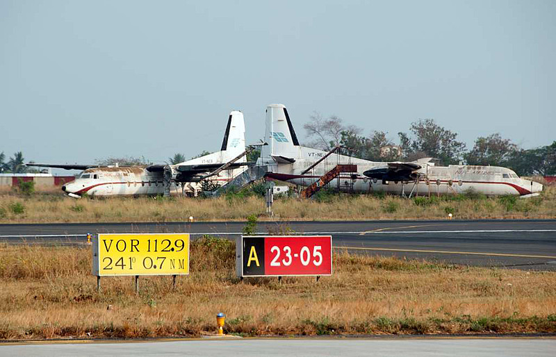 NEPC Airlines Fokker F-27 VT-NEB (left) & VT-NEH, Coimbatore international airport (CJB / VOCB), 22 March 2012.  NEPC operated between 1993 and 1997.