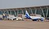 Unidentified Jet Airways Boeing 737-800 (left) & IndiGo Airbus A320-200 VT-INZ, Chennai international airport (MAA / VOMM), 22 March 2012