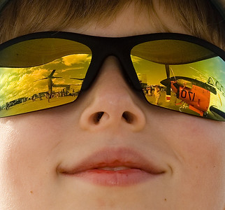 First Place, Air Show Experience Category:  Air show visions are reflected in my son's sunglasses.