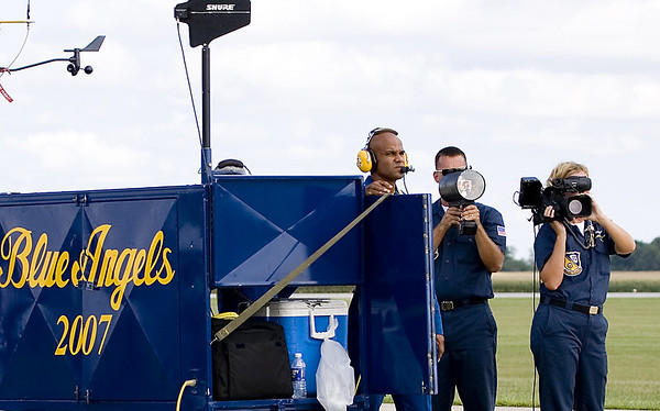 The Blue Angels' gound crew intently watch for and signal the team's next pass.