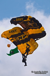 TACOMA, WA – JULY 21: The US Army Golden Knights Parachute Team demonstrate tandem parachuting during Air Expo at McChord Field Joint Base Lewis-McChord on July 21, 2012 in Tacoma, WA.