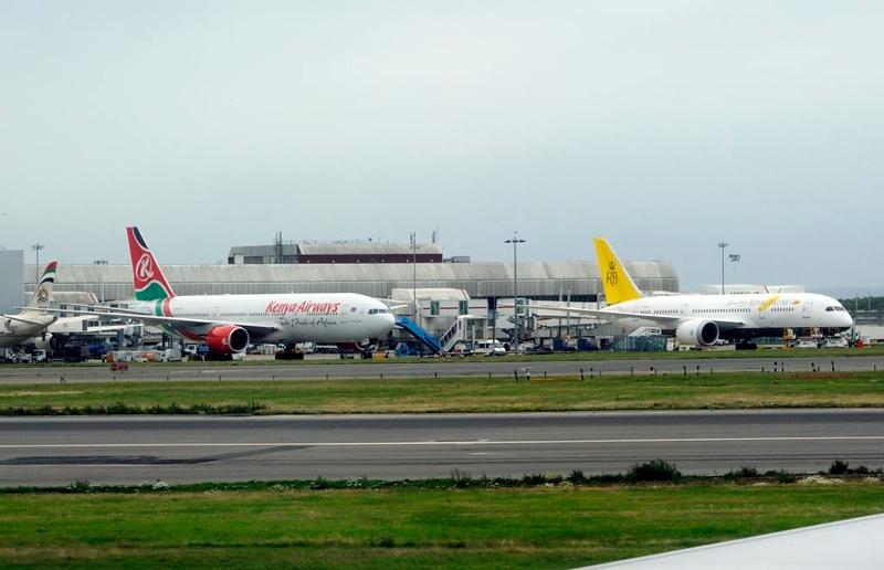 Kenya Airways Boeing 777-200 5Y-KYZ & unidentified Royal Brunei Boeing 787-9, Heathrow Airport, Fri 29 August 2014 - 0955.