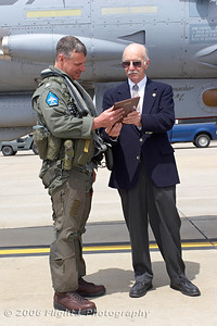 "Floyd Wilson presents CDR Dan ""Slave Boy"" Cave with a plaque commerating the last flight of this Tomcat"