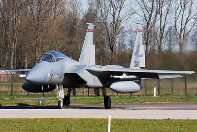 "A USAF F-15C Eagle (80-0024; cn668/C173) from the 123rd Fighter Squadron ""Redhawks"" Oregon ANG, seen taxiing to the active runway at Leeuwarden Air Base, for a morning mission during Frisian Flag 2015. The nose wheel kicks off some dust, while the pilot steers his aircraft through the turn. This F-15C belongs to the 125th Fighter Wing, which leads the first ANG Theater Security Package (TSP) to deploy in support of ""Operation Atlantic Resolve""."