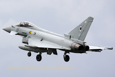 "Royal Air Force Typhoon FGR4 from 11sq. (ZJ933/DF), on final for RWY24 after another mission during Frisian Flag 2012. Note the 36x Paveway II mission marks applied below the cockpit from the recent ""Operation Ellamy"" campaign over Libya."
