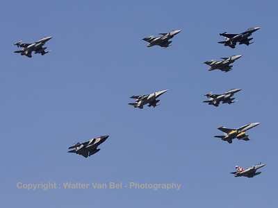 Mass formation fly-by of the 2009 Nato Tiger Meet participants with special c/s. The KB-Tiger (FA-87; cn6H-87) of 31-squadron is leading the flock.