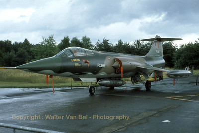 "Belgian Air Force F-104G Starfighter (FX86; cn683-9147) in the static at Kleine Brogel AFB, during a wet gathering of ""tigers""...(1978 Tiger Meet at KB). Scan from old slide."