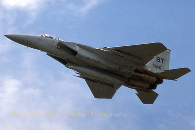 A F-15A Eagle (76-0015; BT; cn194/A167) from 36TFW/53TFS at Bitburg, performing a fly-by at Kleine Brogel AFB during the Tiger Meet photo day. The aircraft has been reported (in 2005) to have been scrapped at Otis ANGB. (Scan from slide).