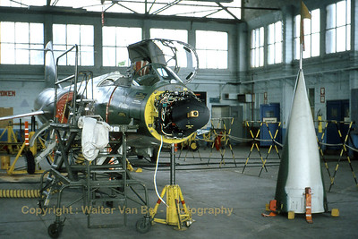 A Belgian Air Force F-104G Starfighter (FX83; cn683-9141) - on jacks - in the maintenance hangar at Kleine Brogel AFB. The nose cone was detached to give a good view on the radar.