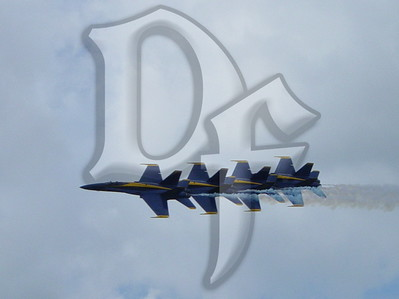 The U.S. Navy's Blue Angels fly in formation at the 2004 Rochester International Air Show, held at the Greater Rochester International Airport.