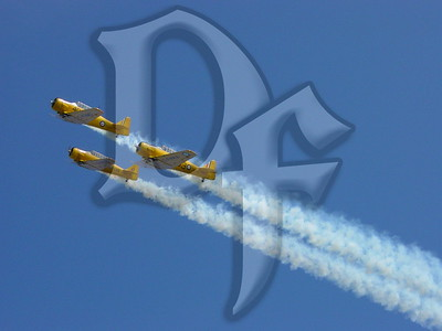 Canadian Harvard Aerobatic Team performs at the 2004 Rochester International Airshow.