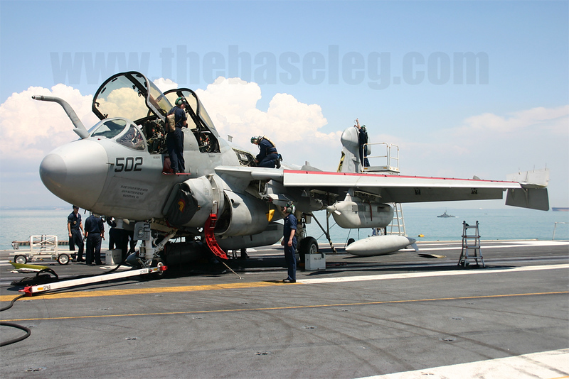 VAQ-131 maintenance crew swarm over EA-6B Prowler 158040/NE-502 on the USS Abraham Lincoln, Changi Naval Base, Singapore in 2005.