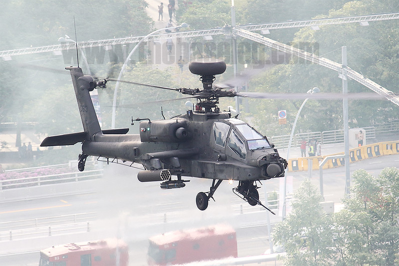 RSAF Longbow Apache over downtown Singapore