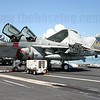 EA-6B Prowler 163035/NE-500 of VAQ-131 Lancers having maintenance done on its radar while the USS Abraham Lincoln is berthed at Changi Naval Base, Singapore in 2005.