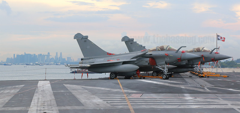 French Navy Rafale Ms on board the aircraft carrier Charles de Gaulle with the Singapore skyline in the background