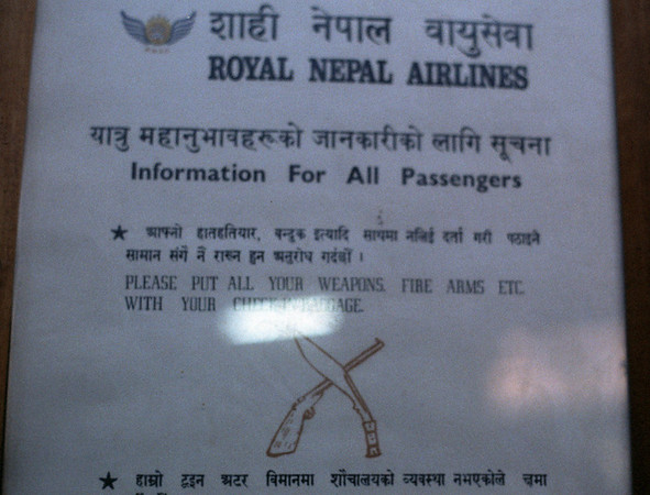 Check in your weapons!  Kathmandu airport, November 1990.