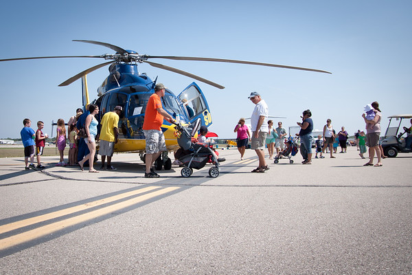 People checking out the U of M chopper