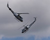 """Photo taken March 15, 2008.  Two Royal New Zealand Air Force Bell UH1 """"Huey"""" helicopters dance for the crowd at the Ohakea Airshow near Bulls, NZ."""