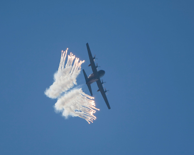 Photo taken March 15, 2008.  A Royal New Zealand Air Force C-130 releases chaff during a demonstration flight at the Ohakea Airshow near Bulls, NZ.