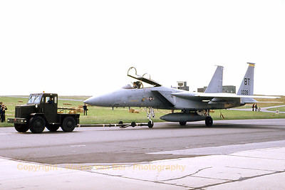 A F-15A Eagle (76-0039; BT; cn221/A191) from the 525th TFS, 36th TFW is being towed away from the static parc during an Open Door at Bitburg AFB in the late seventies. [Scan from slide].