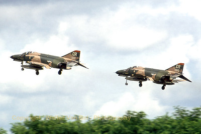 A pair of TISEO-equipped F-4E's (74-0663; CR; cn4814) during take-off from Soesterberg in the late seventies. The lead aircraft (reg. 74-0660) was destroyed on 23/08/1981. (Scanned from slide).