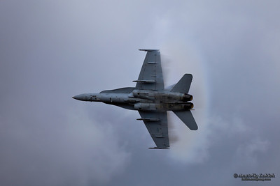 """Boeing F/A-18 Hornet Demo """"Teaser"""" at the 2009 Oregon International Air Show surrounded in vapor cone during demonstration."""