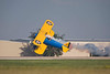 Photo taken July 28, 2007.  A Stearman flown by John Mohr makes a really low pass during EAA Airventure 2007.