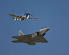 "Photo taken August 1, 2008.  F-22 Raptor and P-51D Mustang ""Excalibur"" during their ""Heritage Flight"" at EAA AirVenture 2008."