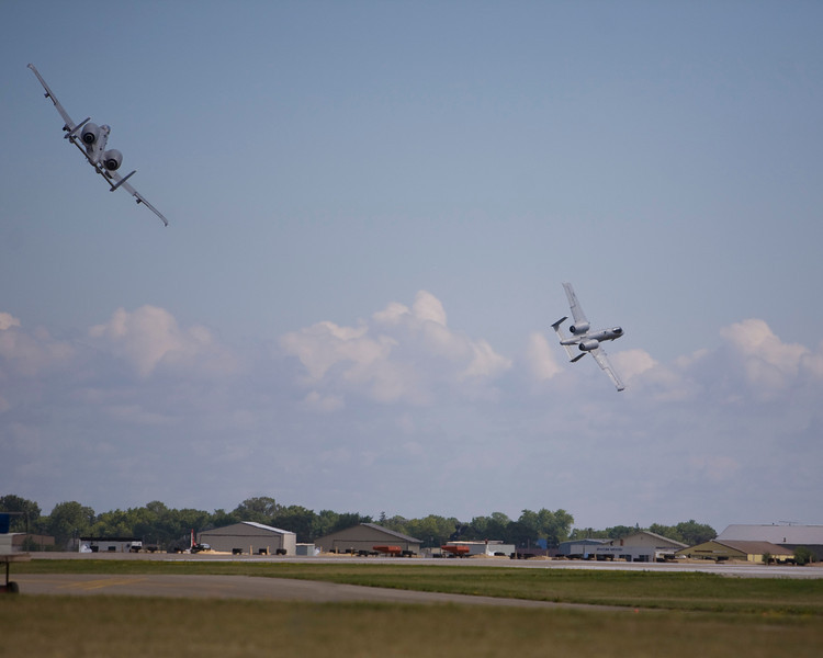 A-10 Warthogs maneuvering at EAA AirVenture 2009.