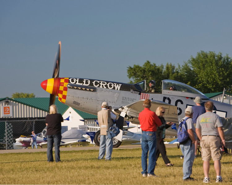 P-51 Mustang taxis for an early morning flight at EAA AirVenture 2009.