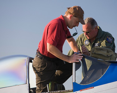 Climbing in to a P-51 Mustang at EAA AirVenture 2009.