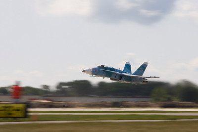 F-18 Hornet making a low pass at EAA AirVenture 2009.