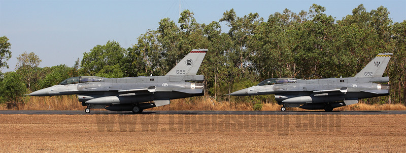 Two RSAF F-16D Block 52s, in the markings of each of the two Tengah-based RSAF F-16 squadrons, hold short near Darwin's Runway 29 awaiting departure for an afternoon Pitch Black mission.
