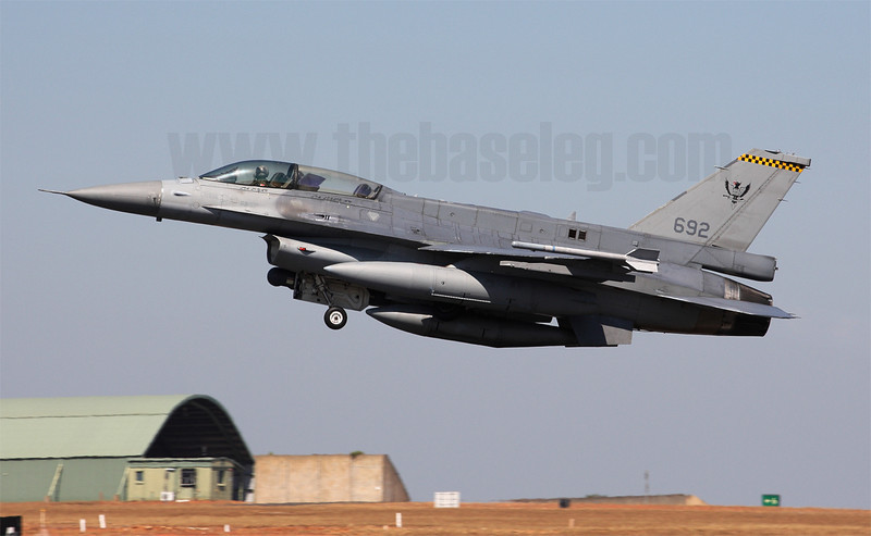 Singapore was the second F-16 user after Israel to sport the distinctive dorsal on its F-16Ds, when the RSAF's first F-16D was rolled out in 1998. Seen here taking off is 692/96-5032, in the markings of Tengah-based 143 Phoenix Sqn