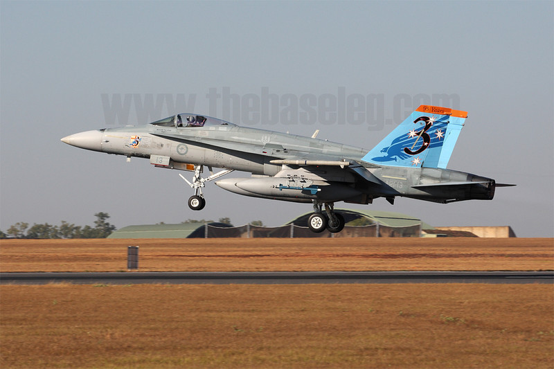 Royal Australian Air Force F/A-18A Hornet A21-13 in a scheme commemorating the 95th Anniversary of 3 Squadron takes off for a Pitch Black Air-to-Ground mission. Note the Lockheed-Martin Paveway II Enhanced Laser Guided Training Round (ELGTR) on the wing pylon