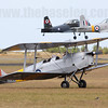 Tiger Moth VH-LJM taxies back while 2 CAC Winjeels take off