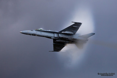 "Boeing F/A-18 Hornet Demo ""Teaser"" at the 2009 Oregon International Air Show surrounded in vapor cone during demonstration."