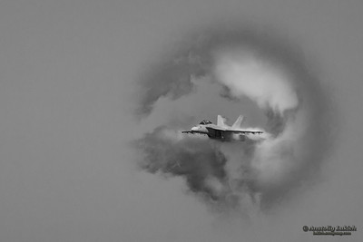SAN FRANCISCO, CA - OCTOBER 8: VFA-122 Boeing F/A-18F Super Hornet aircraft surrounded in vapor cone during 2011 Fleet Week on October 8, 2011 in San Francisco, CA.
