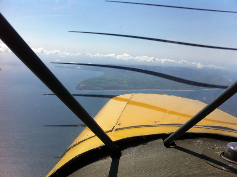 8 Miles north of the Point of Ayre at Flight Level 060. iPhone photo hence propeller banding.
