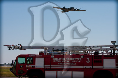 'The Movie' Memphis Belle flies over Rescue 3 during the 2011 ESL International Airshow in Rochester, NY.