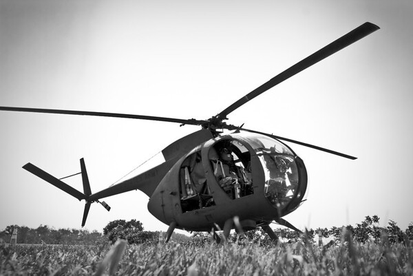 A Vietnam War-era Hughes OH-6 Cayuse, authentically restored in U.S. Army markings.
