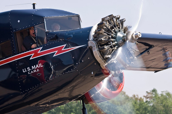 A close-up of the Stinson Tri-Motor after starting engines.