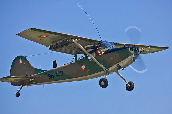 Another Cessna O-1 Bird Dog, also in its original markings of the country of Malta.
