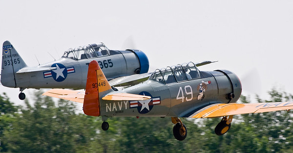 Two T-6 Texans take off in formation.