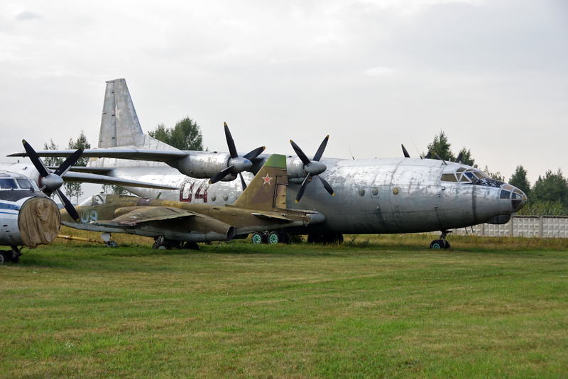 Antonov An-12 04 black, Russian Air Force Museum, Monino, Moscow, 27 August 2015.  In front is  Sukhoi Su-25 09 blue.