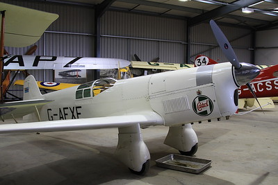 Percival Mew Gull racer, G-AEXF, on display inside one of the hangers at Old Warden - 05/07/15.