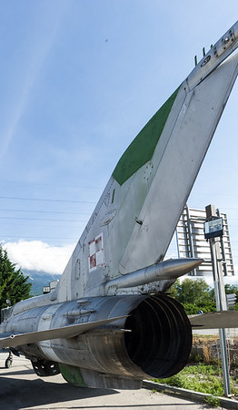 """portes ouvertes aeroport de Sion, le 12 juin 2011.  Located  46°13'11.75"""" /  7°20'58.26""""E - Can be seen when exiting the A9 highway in Sion ouest, Switzerland. On peut voir cette relique à la sortie de l'autoroute A9 Sortie Sion ouest . (Suisse)  Le MIG 21 UM est un chasseur supersonique fabrique en Russie, en Tchecoslovaquie et en Inde (le modele ici est polonais). c'est l'equivalent du Mirage III. Le MIG-21 etait un chasseur-intercepteur a court rayon d'action."""