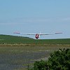 Piloted by Bob Fennell, the Swallow returns to runway 29