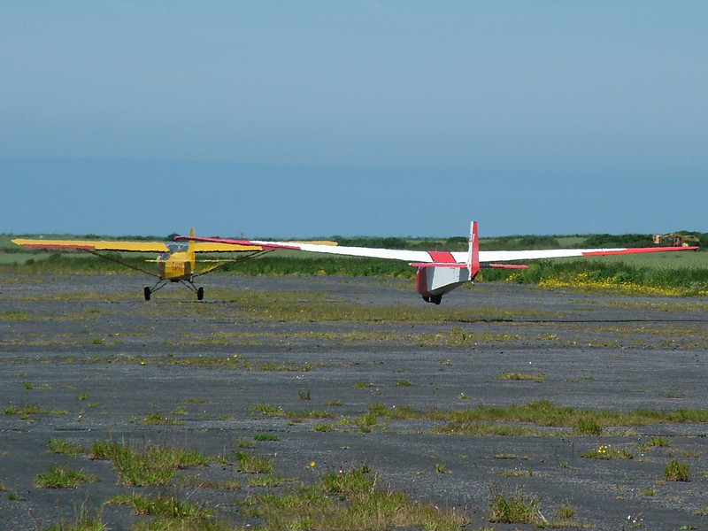 The Auster and Swallow depart of runway 29