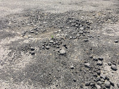 Asphalt at Patterson is in poor condition.  Adjacent fields are more favorable, if they are clear.